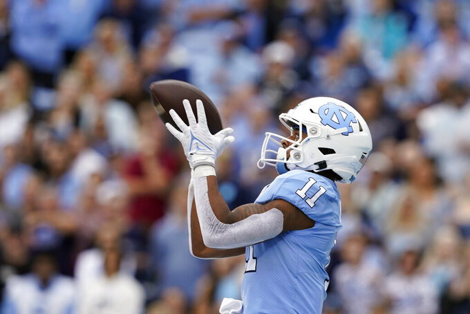 North Carolina wide receiver Josh Downs (11) catches a touchdown pass during the first half of an NCAA college football game against Florida State in Chapel Hill, N.C., Saturday, Oct. 9, 2021. (AP Photo/Gerry Broome)