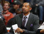 FILE - In this Nov. 30, 2016, file photo, Miami Heat assistant coach Juwan Howard watches during the second half of the team's NBA basketball game against the Denver Nuggets in Denver. A person with knowledge of the situation tells The Associated Press that Howard has agreed to a five-year deal to take over as Michigan men's basketball coach. The person spoke on condition of anonymity Wednesday, May 22, 2019,  because the announcement had not been made. (AP Photo/David Zalubowski, File)