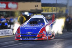 In this photo provided by the NHRA, defending event winner Robert Hight drives in Funny Car qualifying at the NHRA Sonoma Nationals drag races on Friday, July 26, 2019, in Sonoma, Calif. (Richard Wong /NHRA via AP)
