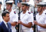 Italy's Prime Minister Giuseppe Conte arrives at Chigi Palace to open the meeting of the cabinet, in Rome, Thursday, Sept. 5, 2019. Italian Premier Giuseppe Conte forged a new coalition government Wednesday that teams up the populist 5-Star Movement and center-left Democrats in an unusual alliance of rivals to banish for now the specter of early election that likely could have seen the triumph of Italy's fast-rising right-wing forces. (Riccardo Antimiani/ANSA via AP)