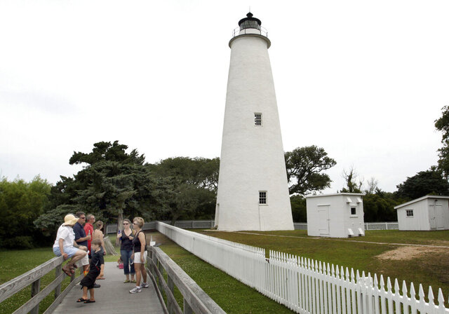 FILE - This Friday, June 5, 2009, file photo shows visitors at the Ocracoke Lighthouse. Park rangers with the Cape Hatteras National Seashore say they are investigating vandalism to the Ocracoke Lighthouse, the oldest operating lighthouse in North Carolina. The Virginian Pilot reports that rangers discovered damage to the lighthouse on Sunday, Oct. 4, 2020. (The Virginian-Pilot via AP, File)