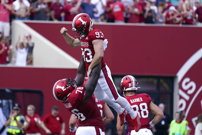 Indiana place kicker Charles Campbell (93) celebrates a 49-yard field goal with Matthew Bedford (76) during the second half of an NCAA college football game against Cincinnati, Saturday, Sept. 18, 2021, in Bloomington, Ind. Cincinnati won 38-24. (AP Photo/Darron Cummings)