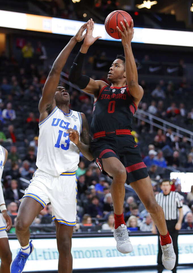 Stanford's KZ Okpala shoots against UCLA's Kris Wilkes during the second half of an NCAA college basketball game in the first round of the Pac-12 men's tournament, Wednesday, March 13, 2019, in Las Vegas. (AP Photo/John Locher)