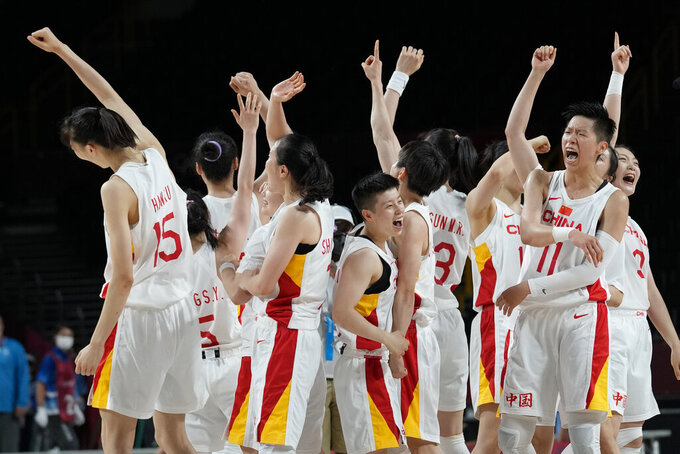 China celebrates their 76-74 victory against Australia after a women's basketball preliminary round game at the 2020 Summer Olympics in Saitama, Japan, Friday, July 30, 2021. (AP Photo/Eric Gay)