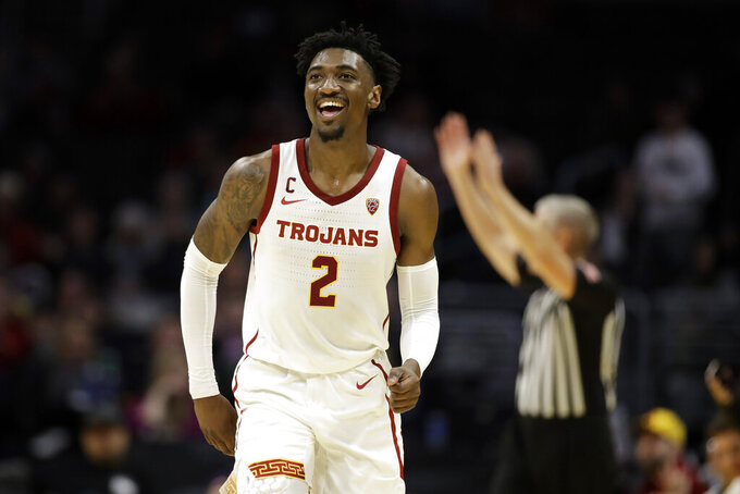 Southern California guard Jonah Mathews (2) smiles after making a three-point basket against LSU during the second half of an NCAA college basketball game Saturday, Dec. 21, 2019, in Los Angeles. (AP Photo/Marcio Jose Sanchez)