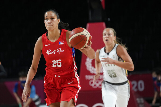 Puerto Rico's Isalys Quinones (25), left, moves the ball up court during women's basketball preliminary round game against Belgium at the 2020 Summer Olympics, Friday, July 30, 2021, in Saitama, Japan. (AP Photo/Eric Gay)