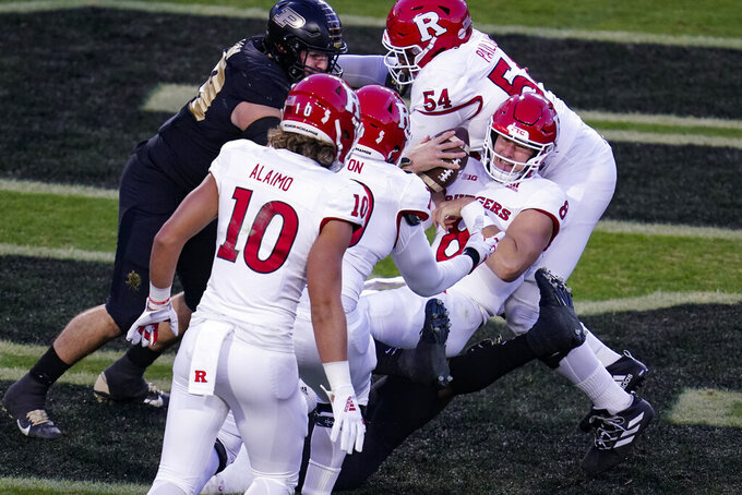 Rutgers quarterback Artur Sitkowski (8) is tackled in the end zone for a safety by Purdue defensive lineman Branson Deen (58) during the second quarter of an NCAA college football game in West Lafayette, Ind., Saturday, Nov. 28, 2020. (AP Photo/Michael Conroy)