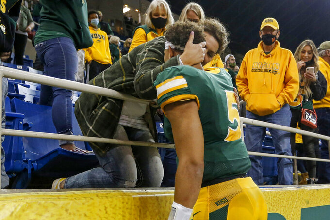 North Dakota State quarterback Trey Lance hugs his mom Angie Lance after defeating Central Arkansas at an NCAA college football game Saturday, Oct. 3, 2020, in Fargo, N.D. North Dakota State won 39-28. (AP Photo/Bruce Kluckhohn)