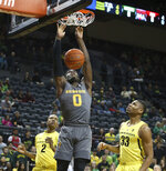 Arizona State's Luguentz Dort, center, dunks between Oregon's Louis King, left, and Francis Okoro, right, during the first half of an NCAA college basketball game Thursday, Feb. 28, 2019, in Eugene, Ore. (AP Photo/Chris Pietsch)