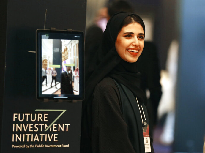 A Saudi organizer at the Future Investment Initiative conference,