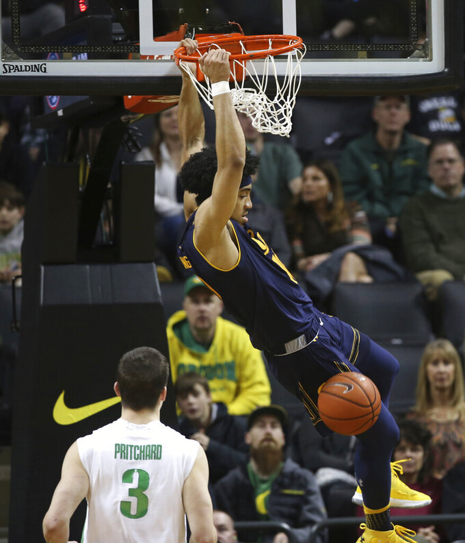 California's Justice Sueing dunks in front of Oregon's Payton Pritchard during the first half of an NCAA college basketball game Wednesday, Feb. 6, 2019, in Eugene, Ore. (AP Photo/Chris Pietsch)