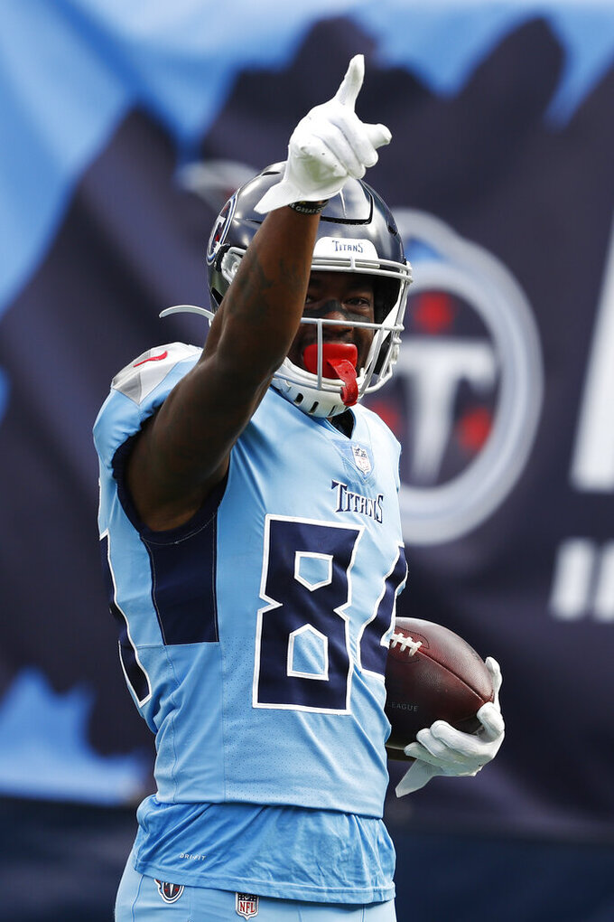 Tennessee Titans wide receiver Corey Davis (84) celebrates after catching a touchdown pass against the Cleveland Browns in the first half of an NFL football game Sunday, Dec. 6, 2020, in Nashville, Tenn. (AP Photo/Wade Payne)