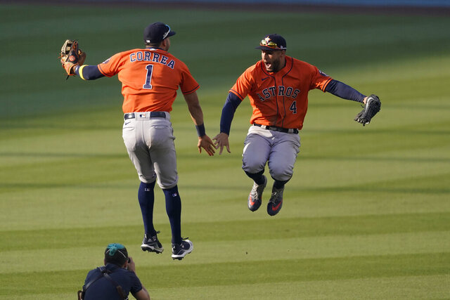 Houston Astros' Carlos Correa, left, celebrates with George Springer after they defeated the Oakland Athletics in Game 1 of a baseball American League Division Series in Los Angeles, Monday, Oct. 5, 2020. (AP Photo/Ashley Landis)