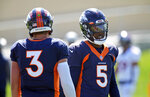 Denver Broncos quarterbacks Teddy Bridgewater, right, and Drew Lock take part in drills during NFL football practice at the team's headquarters Wednesday, Aug. 25, 2021, in Englewood, Colo. (AP Photo/David Zalubowski)