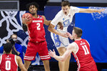 Wisconsin's Aleem Ford (2) grabs a rebound next to North Carolina's Walker Kessler (13) during the first half of a first-round game in the NCAA men's college basketball tournament Friday, March 19, 2021, at Mackey Arena in West Lafayette, Ind. (AP Photo/Robert Franklin)