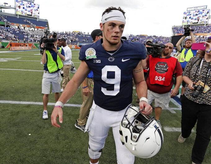Penn State quarterback Trace McSorley walks off the field after losing to Kentucky in the Citrus Bowl NCAA college football game, Tuesday, Jan. 1, 2019, in Orlando, Fla. (AP Photo/John Raoux)