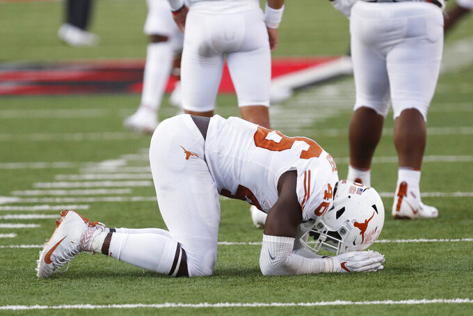 Texas' Joseph Ossai celebrate their win over Texas Tech after an NCAA college football game against Texas Tech, Saturday Sept. 26, 2020, in Lubbock, Texas. (AP Photo/Mark Rogers)