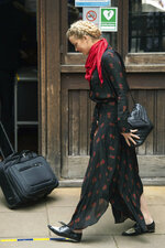 "Actress Amber Heard walks to the High Court for a hearing in Johnny Depp's libel case, in London, Wednesday July 15, 2020. Depp is suing News Group Newspapers, publisher of The Sun, and the paper's executive editor, Dan Wootton, over an April 2018 article that called him a ""wife-beater."" The Sun's defense relies on a total of 14 allegations by Heard of Depp's violence. He strongly denies all of them. (Dominic Lipinski/PA via AP)"