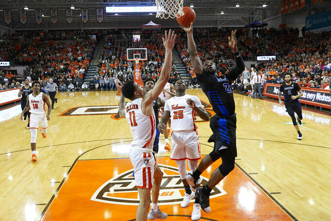 Buffalo guard Jamon Bivens (23) shoots against Bowling Green guard Antwon Lillard (11) and forward Daeqwon Plowden (25) in the second half of an NCAA college basketball game in Bowling Green, Ohio, Friday, Feb. 1, 2019. (AP Photo/Rick Osentoski)