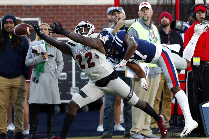 New Mexico State defensive back Shamad Lomax (22) reaches for an overthrown Mississippi pass during the first half of an NCAA college football game in Oxford, Miss., Saturday, Nov. 9, 2019. Lomax did not catch the ball. (AP Photo/Rogelio V. Solis)
