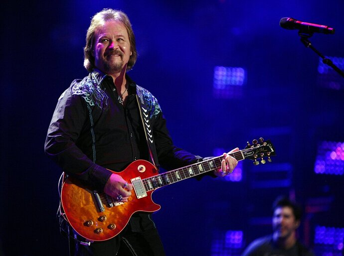 In this Friday, June 6, 2014 file photo, Travis Tritt performs during the CMA Fest at LP Field in Nashville, Tenn. Country music star Tritt says his tour bus was