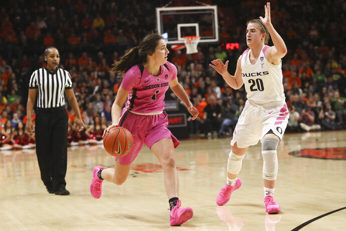 Oregon State's Aleah Goodman (1) looks for a way past Oregon's Sabrina Ionescu (20) during the first half of an NCAA college basketball game in Corvallis, Ore., Monday, Feb. 18, 2019. (AP Photo/Amanda Loman)