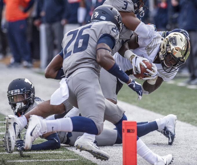 Purdue running back D.J. Knox, right, is pushed out of bounds by the Illinois defense before he can reach the end zone in the first half of an NCAA college football game, Saturday, Oct. 13, 2018, in Champaign, Ill. (AP Photo/Holly Hart)