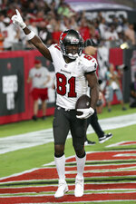 Tampa Bay Buccaneers wide receiver Antonio Brown (81) celebrates his touchdown against the Dallas Cowboys during the first half of an NFL football game Thursday, Sept. 9, 2021, in Tampa, Fla. (AP Photo/Mark LoMoglio)