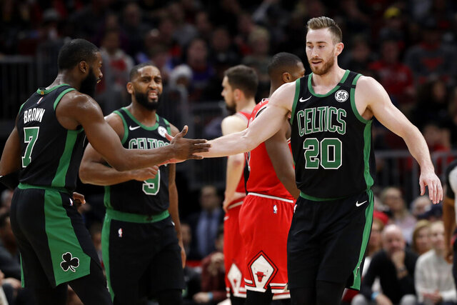 Boston Celtics forward Gordon Hayward, right, celebrates with forward Jaylen Brown after scoring a basket during the first half of the team's NBA basketball game against the Chicago Bulls in Chicago, Saturday, Jan. 4, 2020. (AP Photo/Nam Y. Huh)