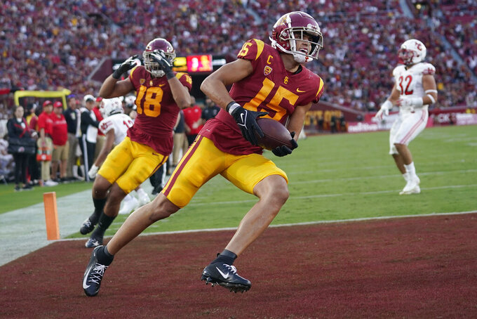 Southern California wide receiver Drake London (15) celebrates his touchdown catch during the first half of an NCAA college football game against Utah, Saturday, Oct. 9, 2021, in Los Angeles. (AP Photo/Marcio Jose Sanchez)