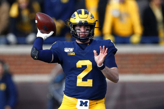 Michigan quarterback Shea Patterson throws a pass against Michigan State in the second half of an NCAA college football game in Ann Arbor, Mich., Saturday, Nov. 16, 2019. (AP Photo/Paul Sancya)
