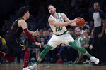 Boston Celtics forward Gordon Hayward (20) sets to drive to the basket against Cleveland Cavaliers forward Cedi Osman (16) during the first half of an NBA basketball game in Boston, Monday, Dec. 9, 2019. Hayward returned to play after breaking his left hand in early November. (AP Photo/Charles Krupa)