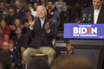 Democratic presidential candidate and former Vice President Joe Biden reacts while John Kerry, the former secretary of state and 2004 Democratic presidential nominee speaks at a campaign event in Nashua, N.H. Sunday, Dec. 8, 2019. (AP Photo/Cheryl Senter)