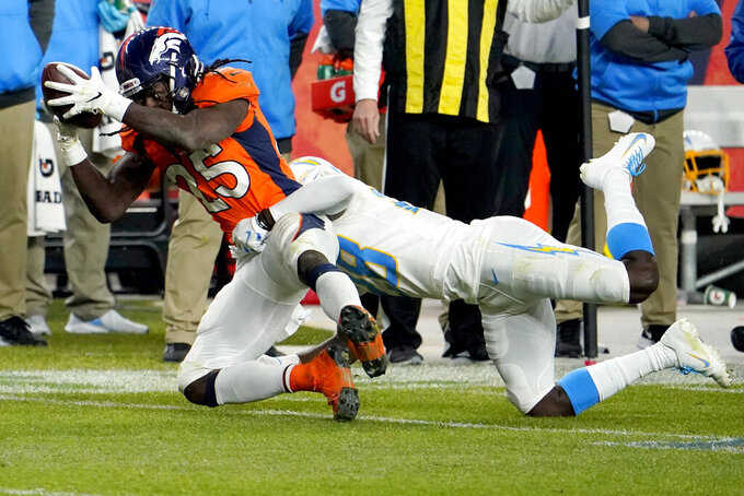 Denver Broncos running back Melvin Gordon (25) stretches for the first down as Los Angeles Chargers cornerback Brandon Facyson defends during the second half of an NFL football game, Sunday, Nov. 1, 2020, in Denver. (AP Photo/Jack Dempsey)