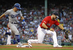 Los Angeles Dodgers' Austin Barnes is out at first on a ground ball as Boston Red Sox first baseman Michael Chavis catches the throw from third during the second inning of a baseball game at Fenway Park, Friday, July 12, 2019, in Boston. (AP Photo/Elise Amendola)