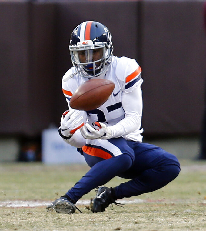Virginia wide receiver, Tavares Kelly (27) bobbles a pass during the first half of an NCAA college football game against Virginia Tech, in Blacksburg, Va., Friday, Nov. 23, 2018. (AP Photo/Steve Helber)