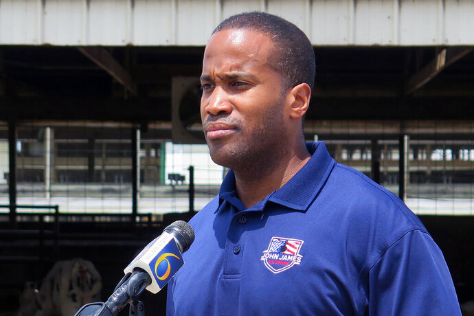 "FILE - In this Monday, June 22, 2020, file photo, Republican U.S. Senate candidate John James speaks at Weir Farms in Hanover Township, Mich. First-term Democratic Sen. Gary Peters of Michigan is trying to hang onto his seat. The low-key, understated, maybe even ""boring"" senator is betting voters care more about his effectiveness as he desperately fights to keep a seat his party is counting on to take the Senate majority. Peters is finding it tougher to shake Republican John James. Michigan has something it has not seen in 20 years: a competitive Senate contest.  (AP Photo/David Eggert, File)"