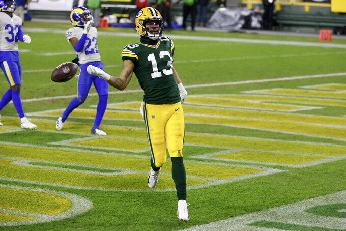Green Bay Packers' Allen Lazard celebrates after a 58-yard touchdown run during the second half of an NFL divisional playoff football game against the Los Angeles Rams Saturday, Jan. 16, 2021, in Green Bay, Wis. (AP Photo/Matt Ludtke)