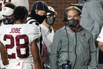 A masked Alabama coach Nick Saban speaks with defensive back Josh Jobe (28) during the second half of the team's NCAA college football game against Mississippi in Oxford, Miss., Saturday, Oct. 10, 2020. Alabama won 63-48. (AP Photo/Rogelio V. Solis)