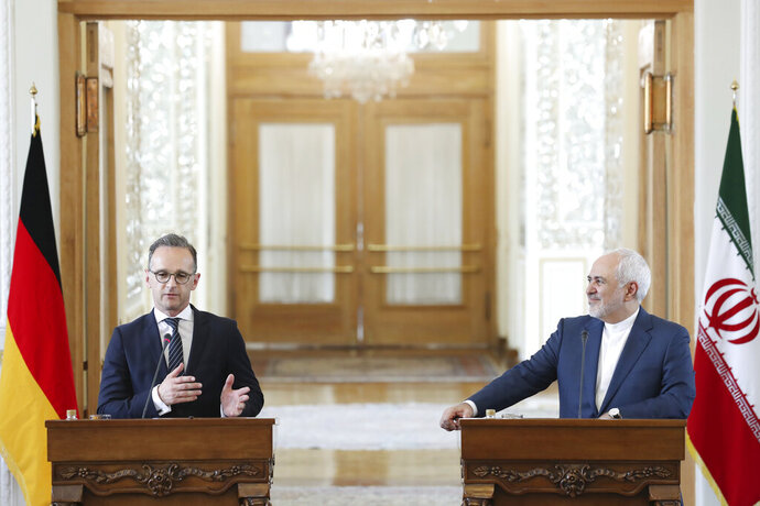 German Foreign Minister Heiko Maas, left, speaks during a press conference with his Iranian counterpart Mohammad Javad Zarif after their talks in Tehran, Iran, Monday, June 10, 2019. Iran's foreign minister warned the U.S. on Monday that it