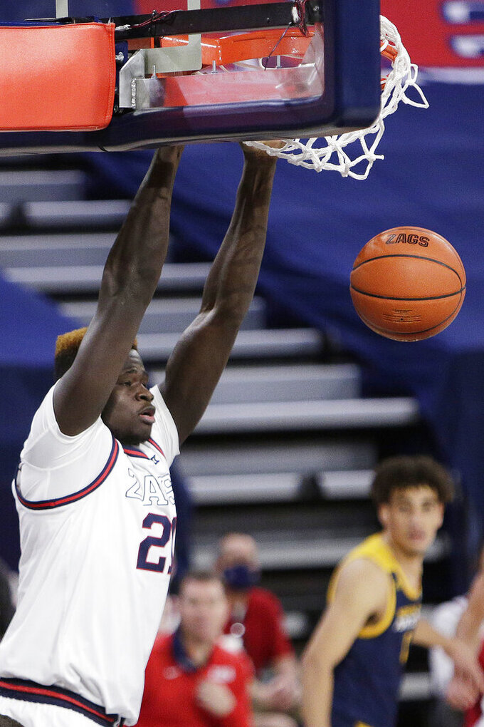 Gonzaga center Oumar Ballo dunks during the second half of the team's NCAA college basketball game against Northern Arizona in Spokane, Wash., Monday, Dec. 28, 2020. Gonzaga won 88-58. (AP Photo/Young Kwak)