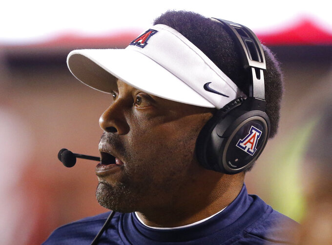 Arizona coach Kevin Sumlin watches during the first half of the team's NCAA college football game against Utah on Friday, Oct. 12, 2018, in Salt Lake City. (AP Photo/Rick Bowmer)