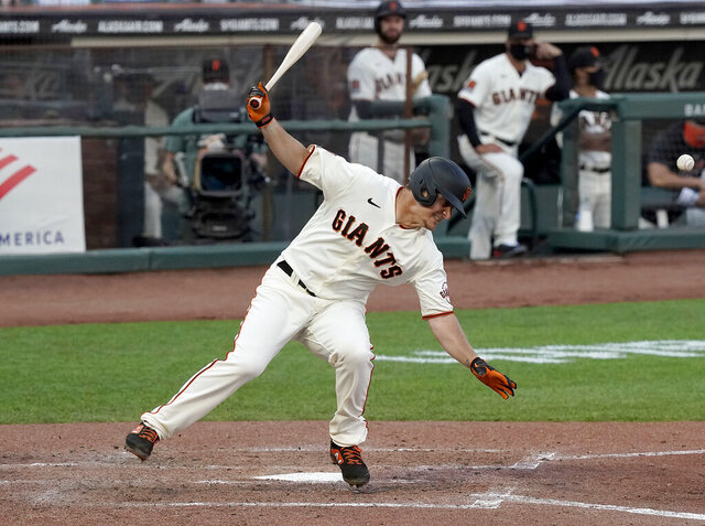 San Francisco Giants' Alex Dickerson spins around after getting hit by a ball that bounced off his bat during the fifth inning of a baseball game against the Arizona Diamondbacks, Monday, Sept. 7, 2020, in San Francisco. (AP Photo/Tony Avelar)