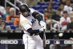 Miami Marlins' Harold Ramirez hits a single during the fifth inning of the team's baseball game against the Los Angeles Dodgers, Wednesday, Aug. 14, 2019, in Miami. (AP Photo/Lynne Sladky)