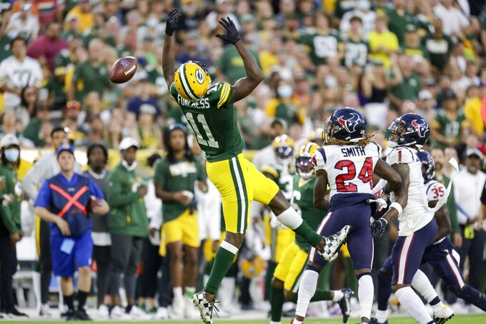 Green Bay Packers' Devin Funchess can't catch a pass during the first half of a preseason NFL football game against the Houston Texans Saturday, Aug. 14, 2021, in Green Bay, Wis. (AP Photo/Matt Ludtke)