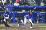 Toronto Blue Jays' Bo Bichette swings and misses for strike three during the ninth inning of a baseball game against the Boston Red Sox on Monday, July 19, 2021, in Buffalo, N.Y. (AP Photo/Joshua Bessex)