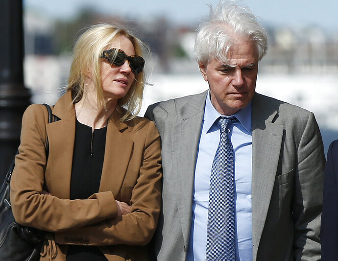Marcia, left, and Gregory Abbott leave federal court, Wednesday, May 22, 2019, in Boston, where they pleaded guilty to charges in a nationwide college admissions bribery scandal. (AP Photo/Michael Dwyer)