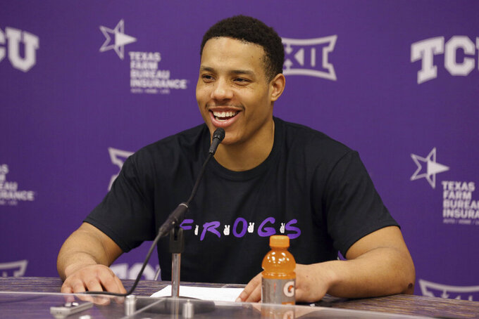 FILE - In this Feb. 29, 2020, file photo, TCU guard Desmond Bane (1) speaks to the media after a 75-72 win over Baylor in an NCAA college basketball game in Fort Worth, Texas. Bane was selected to the Associated Press All-Big 12 first team announced Tuesday, March 10, 2020.(AP Photo/Richard W. Rodriguez, File)
