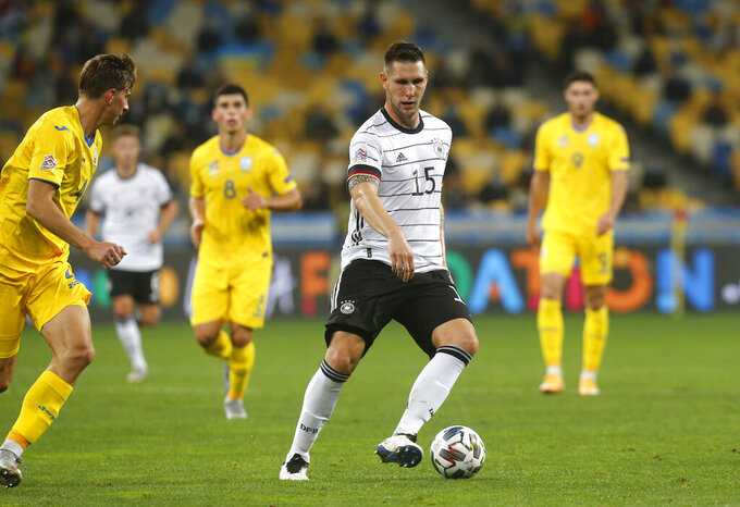 Germany's Niklas Sule in action during the UEFA Nations League soccer match between Ukraine and Germany at the Olimpiyskiy Stadium in Kyiv, Ukraine, Saturday, Oct.10, 2020. (AP Photo/Efrem Lukatsky)
