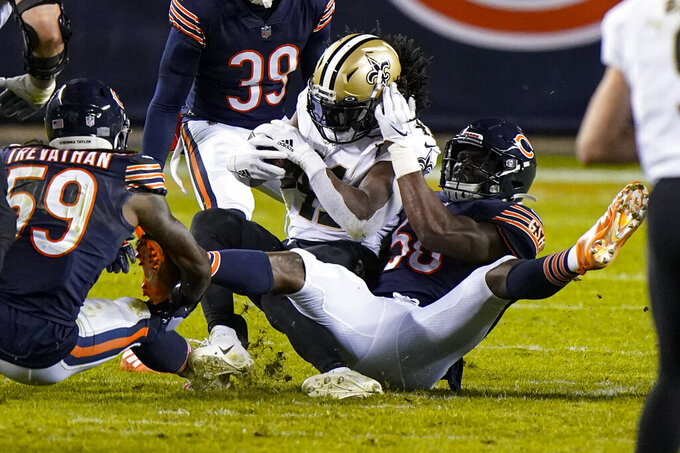 Chicago Bears outside linebacker Barkevious Mingo (50) tackles New Orleans Saints running back Alvin Kamara (41) in the second half of an NFL football game in Chicago, Sunday, Nov. 1, 2020. (AP Photo/Nam Y. Huh)